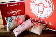 Shipley Farm's red packaging with logo and beef products