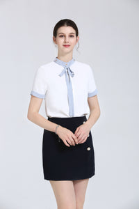 White Blouse With Light Blue Tie At Neck