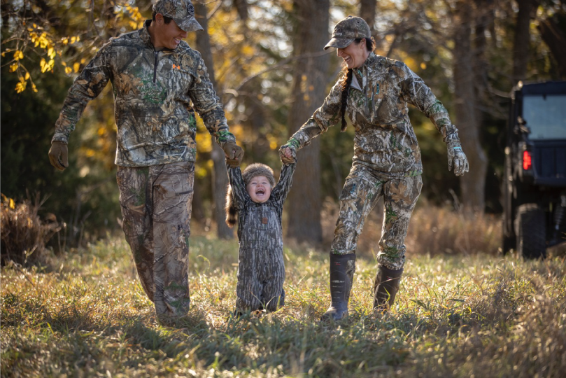 Family-with-Child-Wearing-Camo-Walking-Through-a-Field-in-the-Fall-Ranger-Ready-Repellents