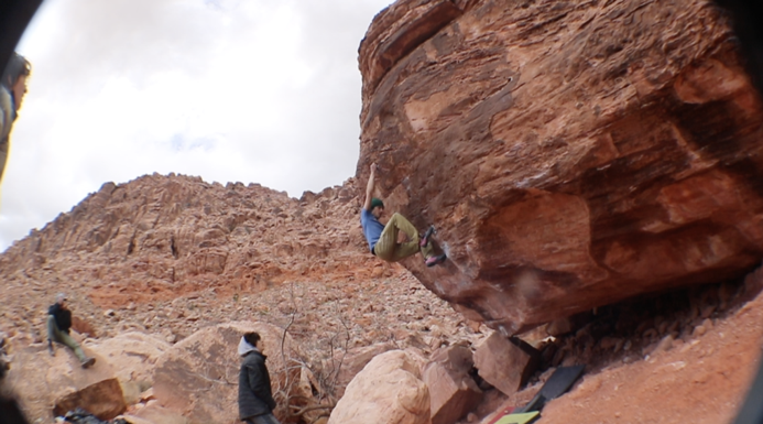 austin hoyt climing a red rock