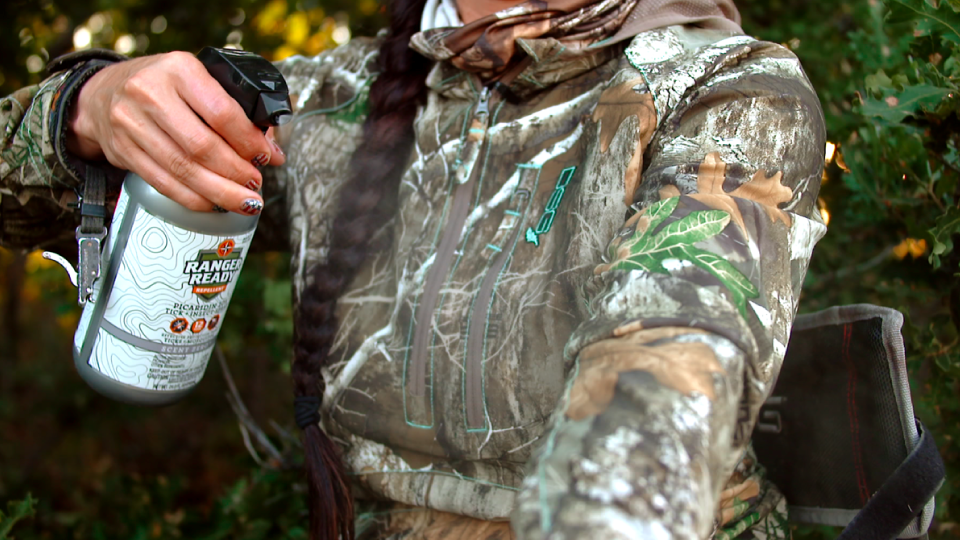 Spraying-Hunting-Clothing-with-Ranger-Ready-Repellent-Odorless-Bug-Spray