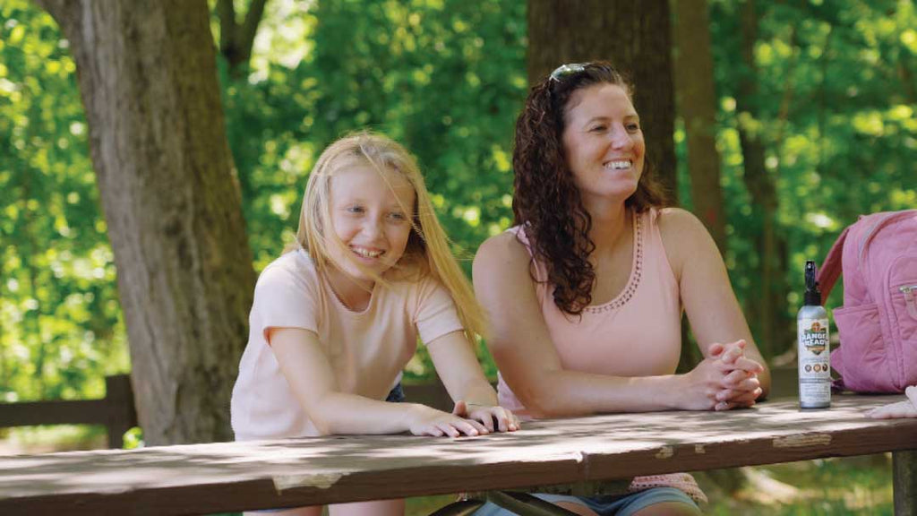mom-and-daughter-laughing-sitting-on-park-bench-in-the-summer.jpg