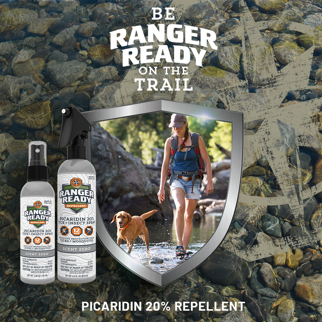 Ranger Ready Repellents Picaridin Icaridin woman and dog hiking through trail in shallow water with ranger ready repellents