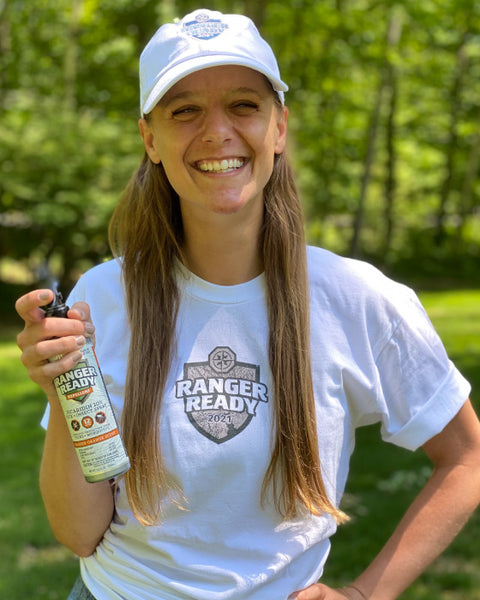 woman-in-the-summer-wearing-white-hat-and-holding-ranger-ready-bug-spray