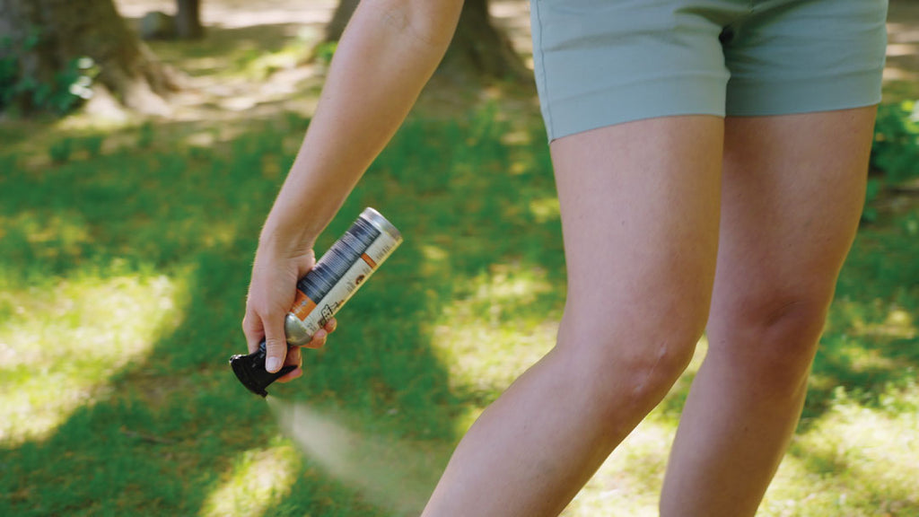 woman-spraying-legs-with-picaridin-insect-spray