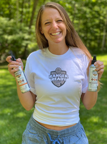 Woman-Holds-Bug-Spray-In-The-Summer