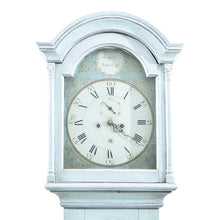 Mora clock face in original light blue