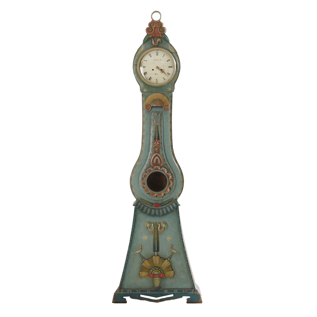 Mora clock in original blue paint with carved detailing