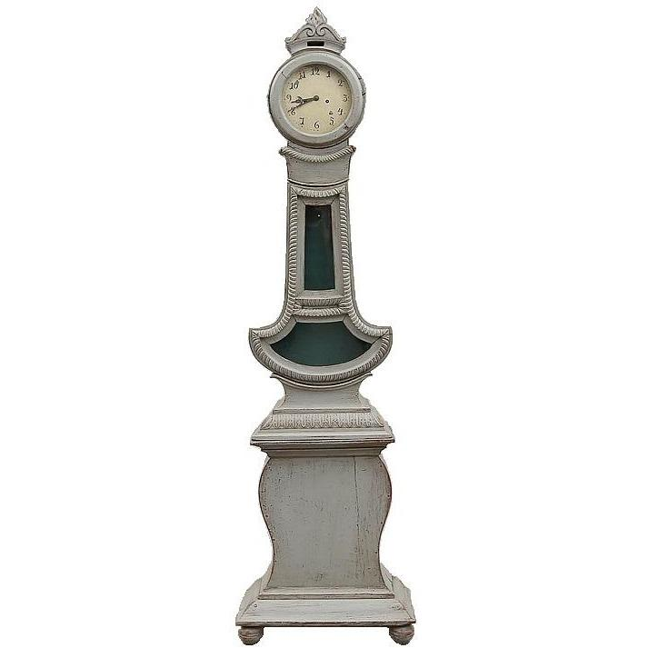 Mora clock in grey with unusual carvings