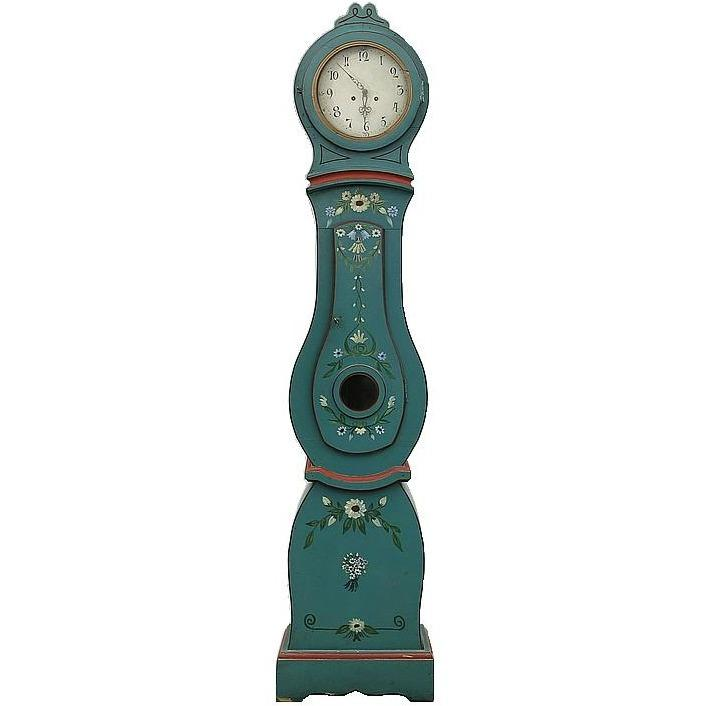 Turquoise Mora clock with painted flowers