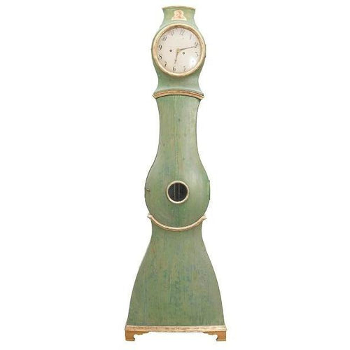 Green Mora clock with gold detail