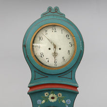 Face of turquoise Mora clock with painted flowers