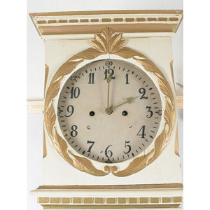 Face of male Swedish Mora clock in cream and gold