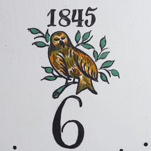 Painted bird detail on face of 1845 Mora Clock