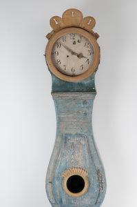 Body and face of blue Mora Clock with carving