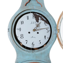 Mora clock face with initials and 'Mora'