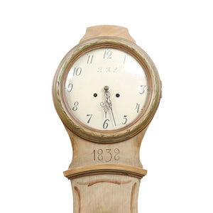 mora clock with natural floral detail and clockmaker initials