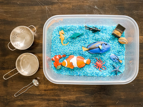 Safari TOOB and Incredible Creatures figures in a Sensory Bin with Rice