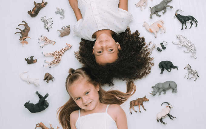 Girls playing with Animal Toys