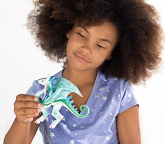 Girl holding a dragon toy