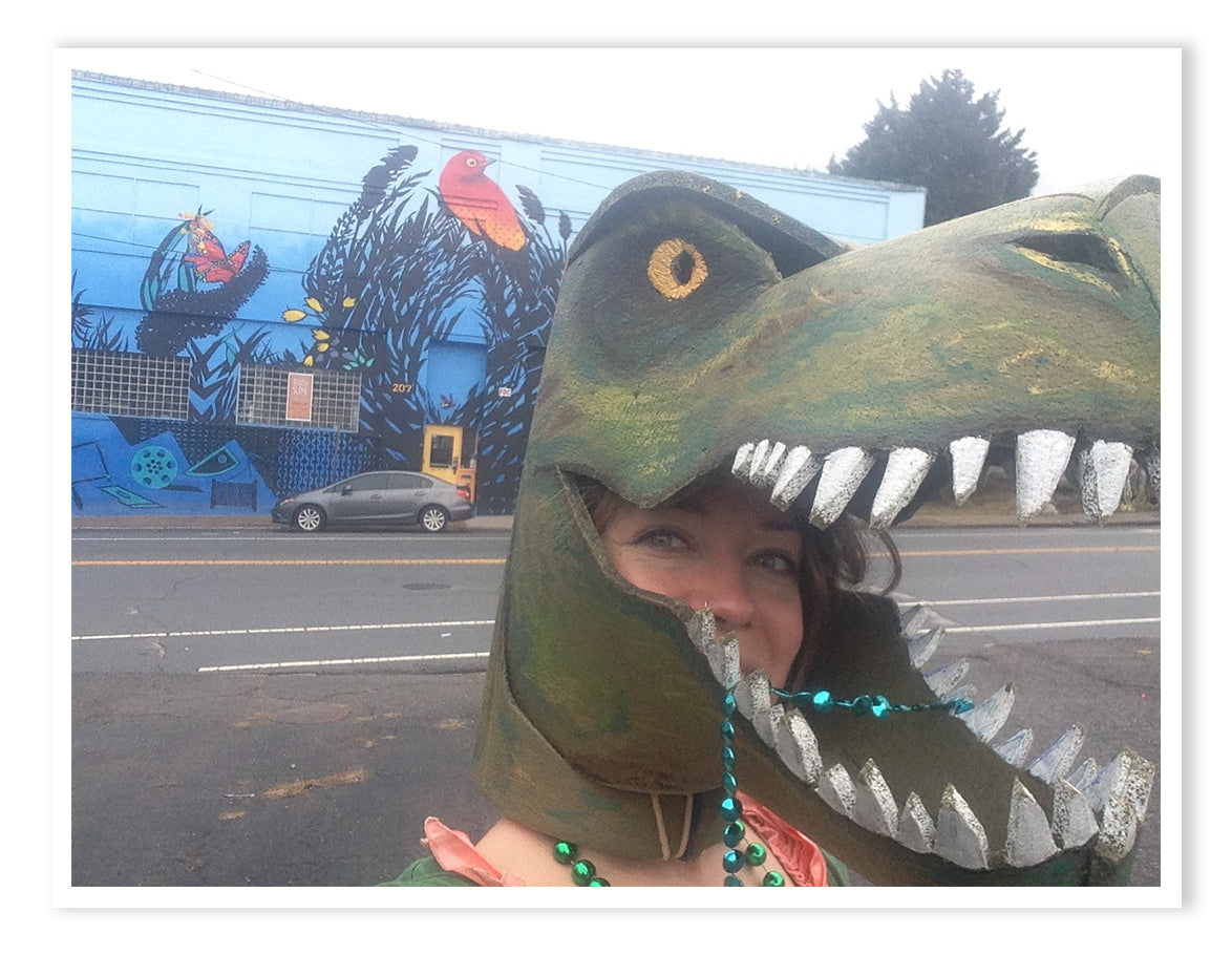 Britta dressed as a dinosaur.