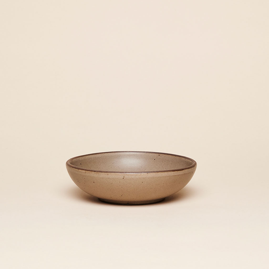 The Everyday Bowl in a creamy, medium brown glaze called Morel by East Fork Pottery.