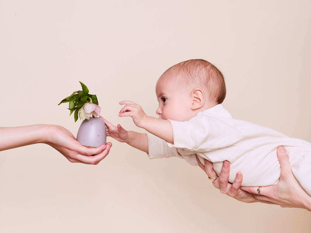 Lucia reaches for the Small Egg Vase in Taro by East Fork Pottery.  Handmade in the USA
