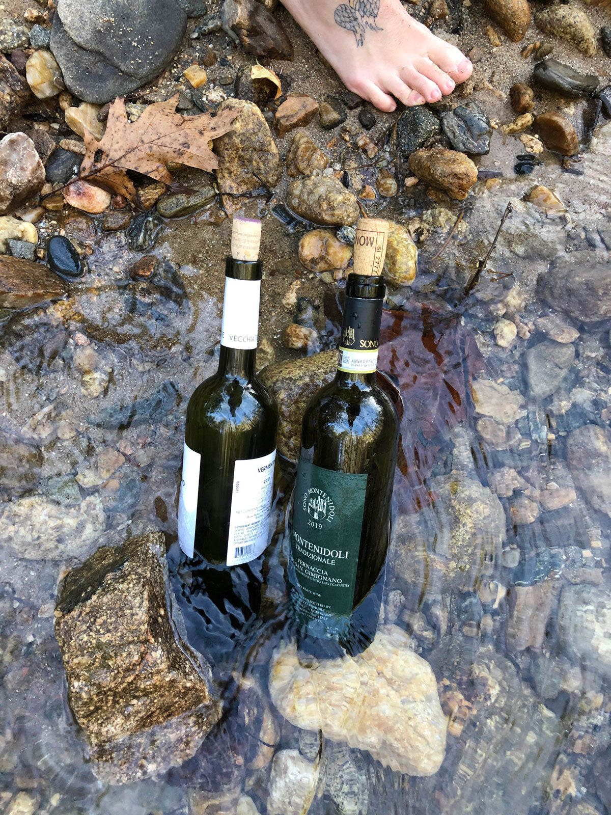 Keeping wine cool in the river.