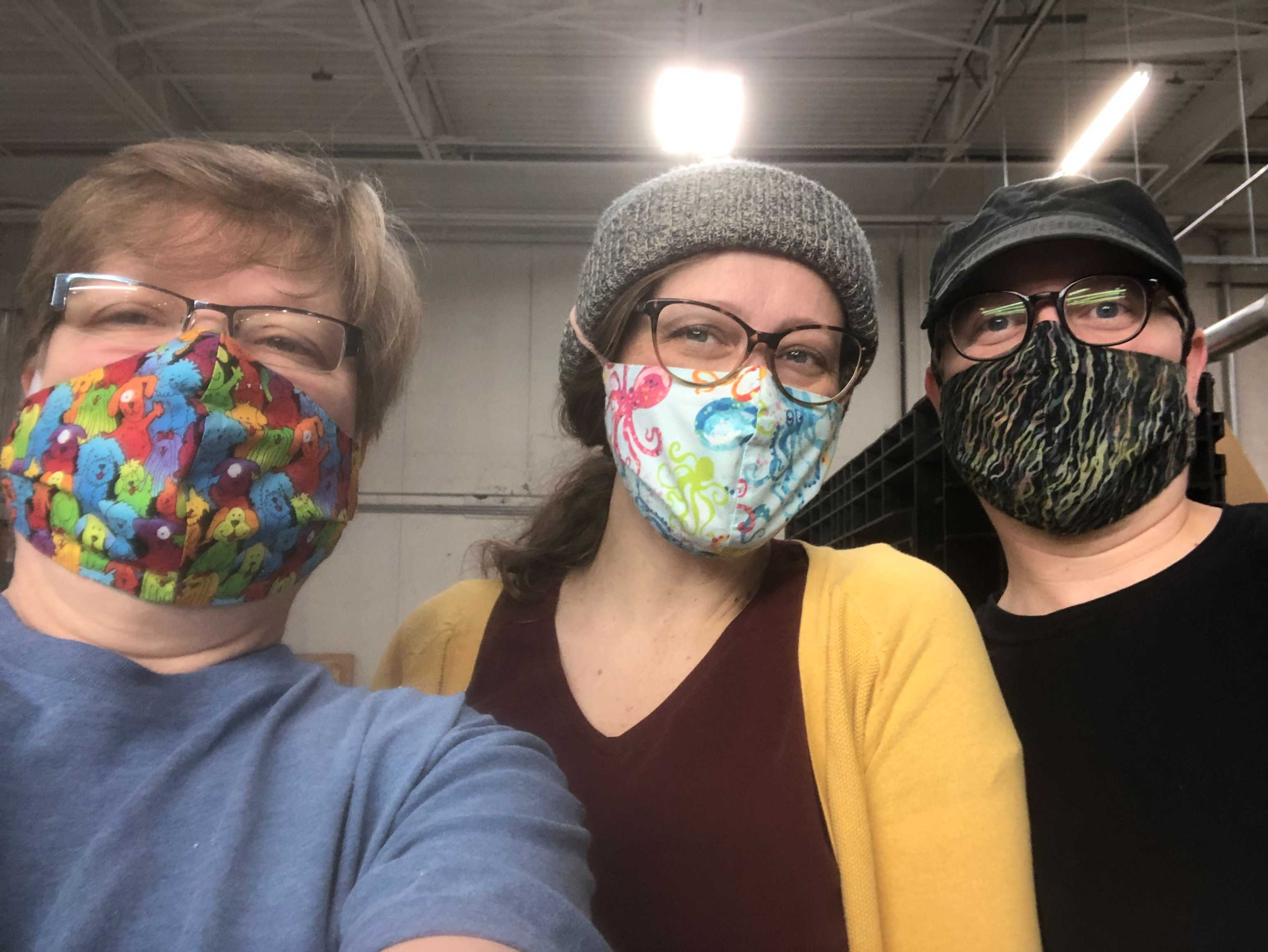 Talea with East Fork employees Lisa and Brock wearing masks