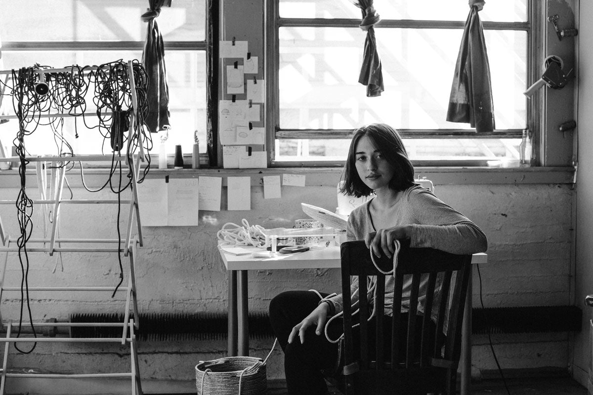Lindsey at 18 in her first sewing studio