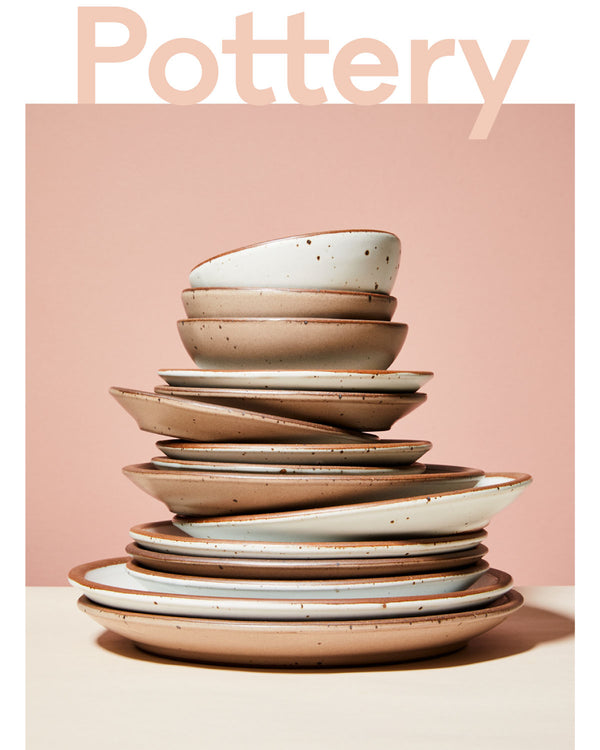 Stack of East Fork pottery