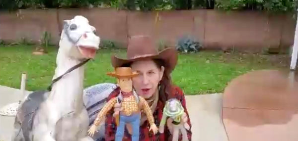 Connie's Mom holds a Buzz Light Year and Woody Doll