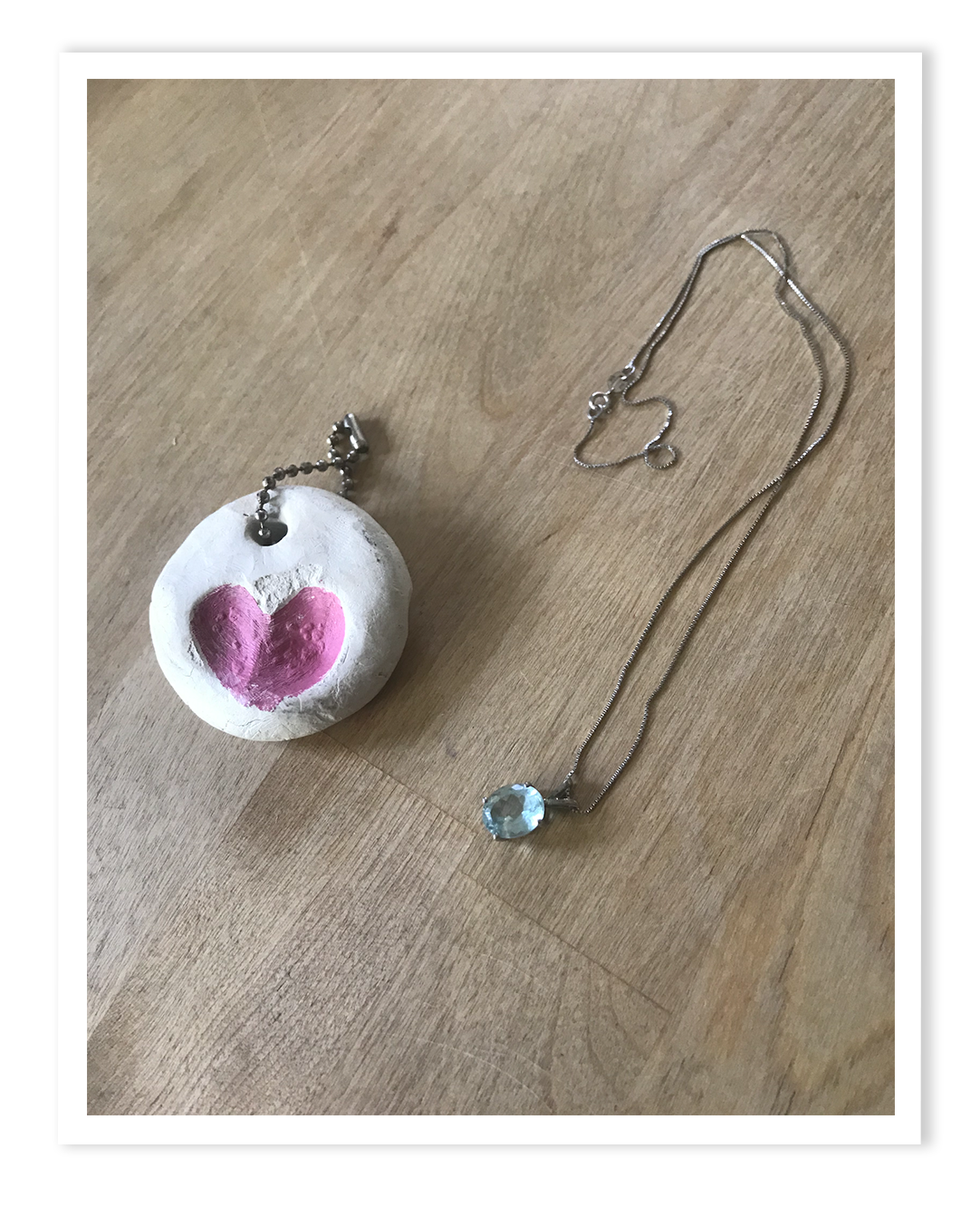 A necklace and charm made by Nicole's child