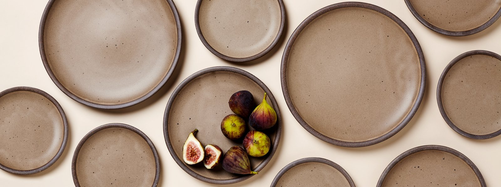 The Dinner Plate, Side Plate and Cake Plate by East Fork Pottery in Morel glaze with ripe purple figs placed in the center