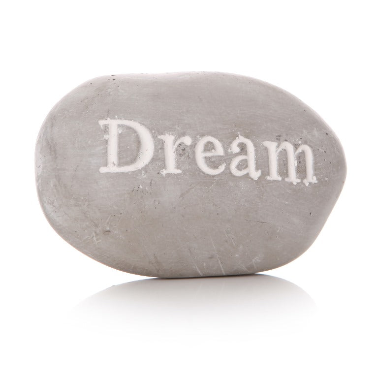Grey pebble with 'DREAM' writing in white