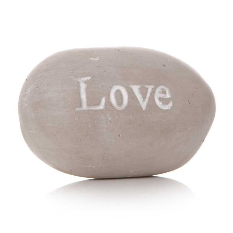 Grey pebble with 'LOVE' writing in white