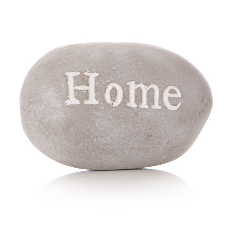 Grey pebble with 'HOME' writing in white