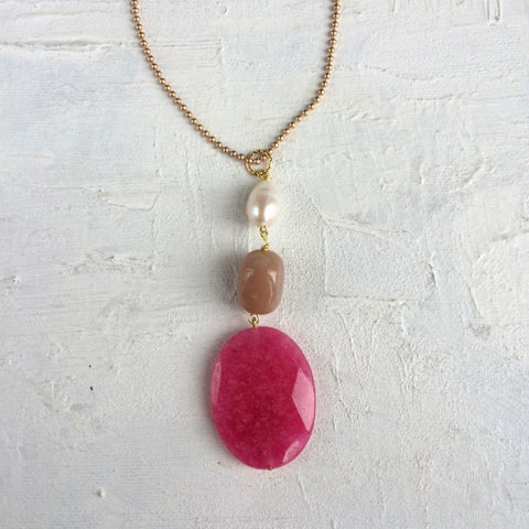 long pendant necklace with pink chalcedony, taupe jade and a freshwater pearl on a gold plated ball chain