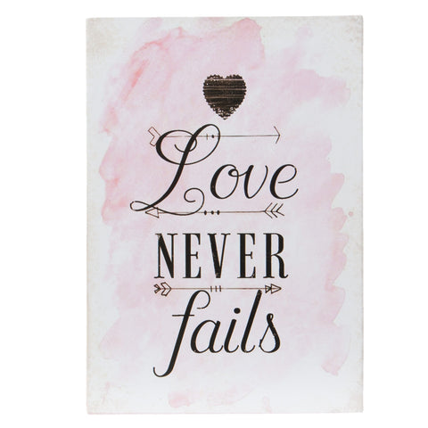 Pink ink splashed poster with Love never fails in black calligraphy