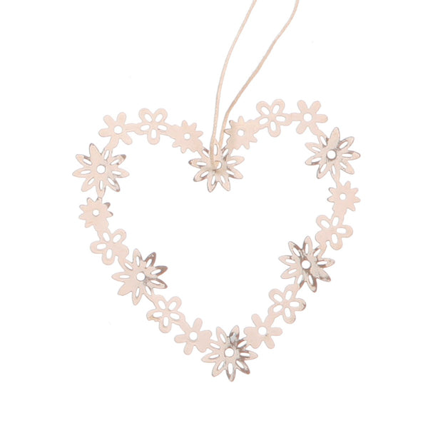 A heart shape made of white metal flowers, and hanging from string