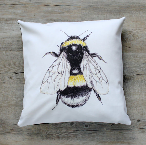 bee cushion on white material
