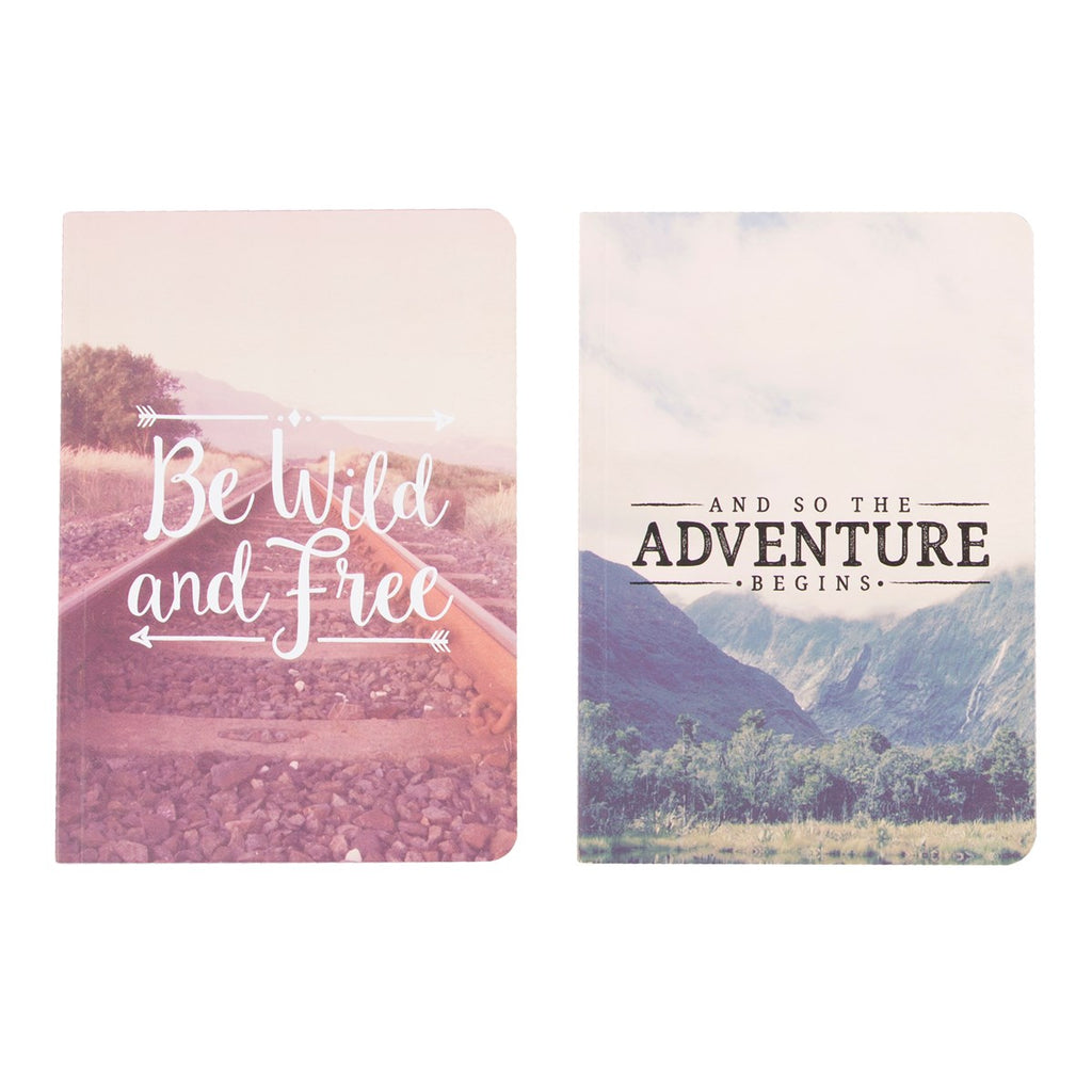 2 note books with inspirational travel quotes
