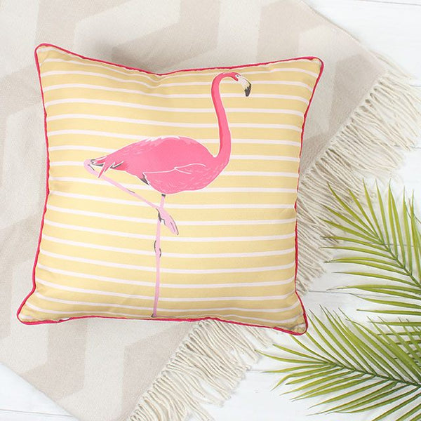 pink flamingo cushion on yellow stripped background