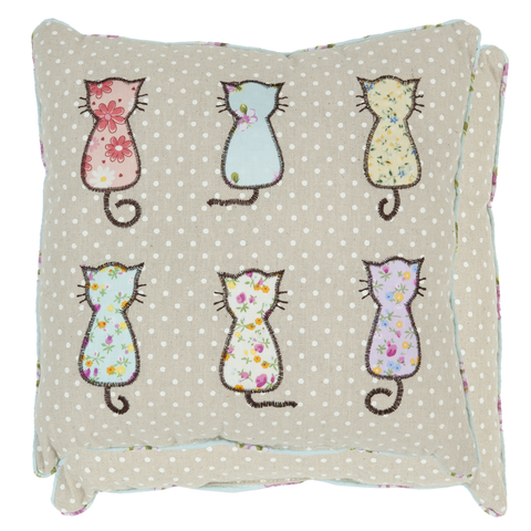 Six patterned cats on a polka dot cushion