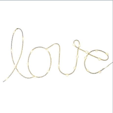 'LOVE' LED light sign in handwritten font