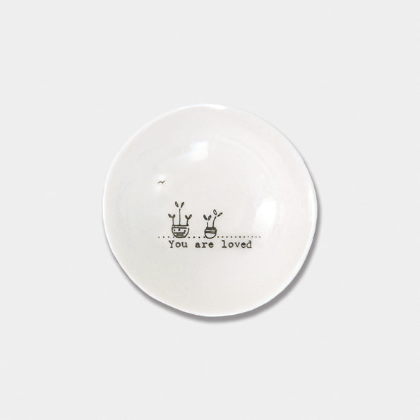 White plate with 'You Are Loved' quote