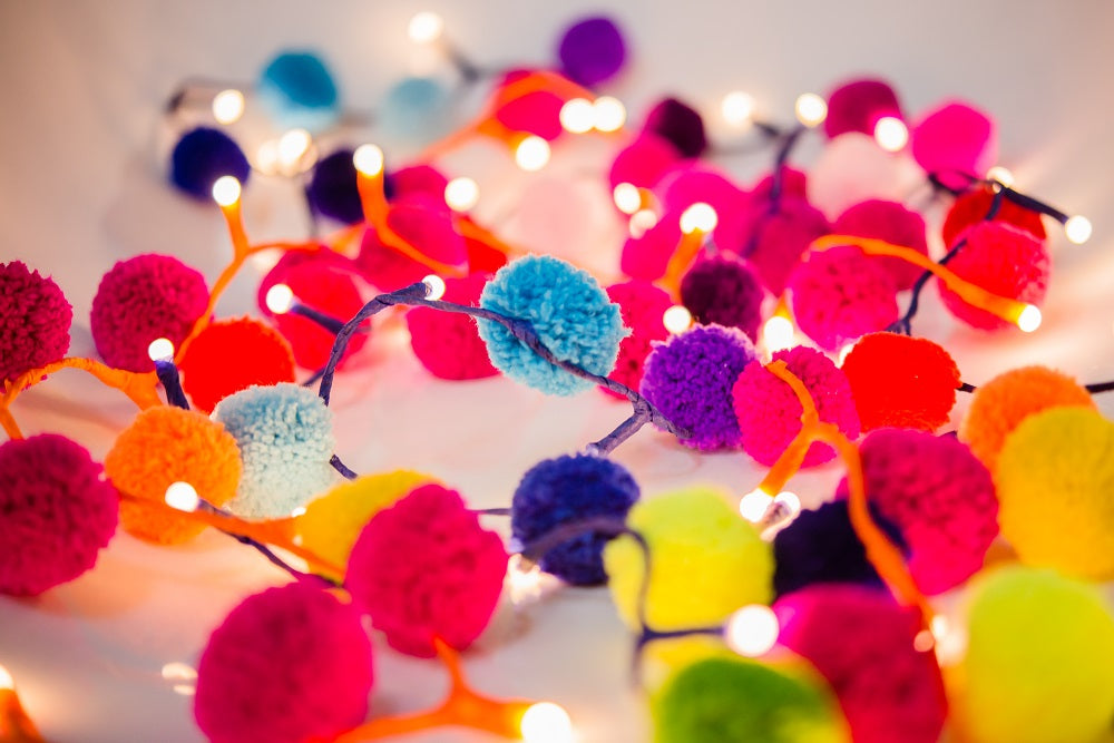 multicoloured pompom garland with lights