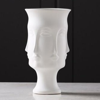 White matte glazed face Ceramic vase