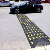 Safety Rider Rubber Speed Bumps with End Cap Spanning Road Image