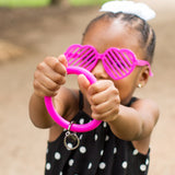 girl holding bangle in heart sunglasses
